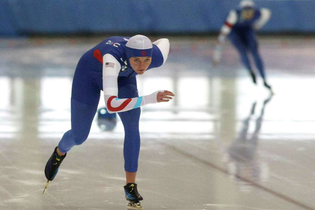 Heather Richardson, left, competes in the women's 1,000 meters, which she won, at the U.S. Long Track Championships speedskating event, Saturday, Dec. 29, 2012, in Kearns, Utah. (AP Photo/The Salt Lake Tribune, Chris Detrick) DESERET NEWS OUT LOCAL TV OUT MAGS OUT
