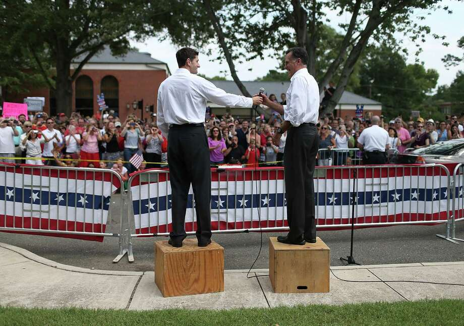 Republican presidential candidate and former Massachusetts Govermor Mitt Romney (R) and Rep. Paul Ryan (R-WI) (L) speak to an overflow crowd during a campaign rally at Randolph Macon College on August 11, 2012 in Ashland, Virginia. Mitt Romney kicked off a four day bus tour with an announcement of his running mate, Rep. Paul Ryan (R-WI). Photo: Justin Sullivan, Getty Images / 2012 Getty Images