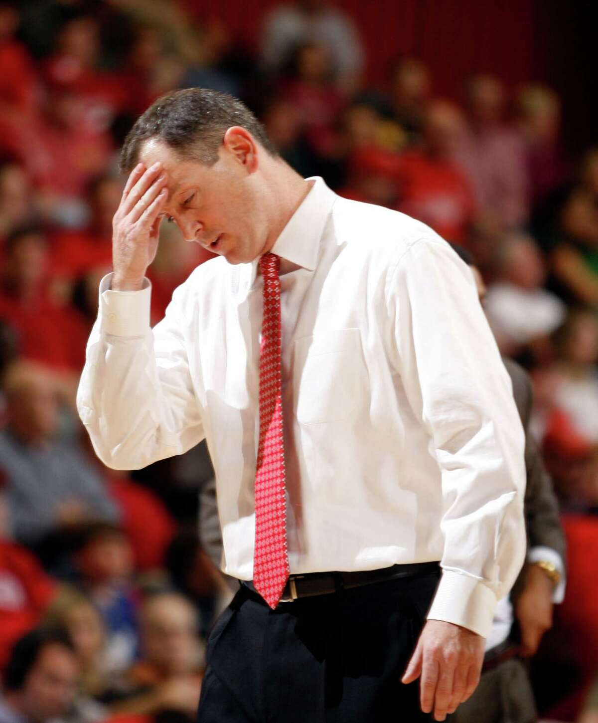 Rutgers Head Coach Mike Rice rubs his head after calling a timeout against Miami during the second half at the Rutgers Athletic Center in Piscataway, NJ on 11/21/10. (Frank H. Conlon/For The Star-Ledger) TO PURCHASE THIS PHOTO, CALL THE STAR-LEDGER PHOTO LIBRARY AT 973-392-1530