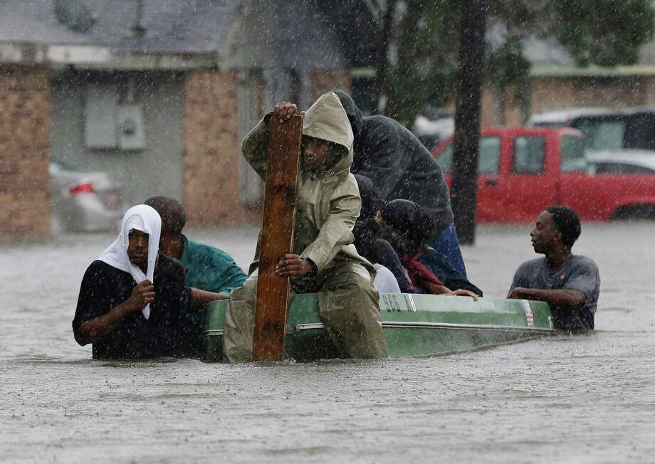 In this Aug. 30, 2012 file photo, residents evacuate their flooded neighborhood in LaPlace, La. Hurricane Isaac staggered toward central Louisiana, its weakening winds driving storm surge into portions of the coast and the River Parishes between New Orleans and Baton Rouge. Photo: Eric Gay, ASSOCIATED PRESS / The Associated Pres2012