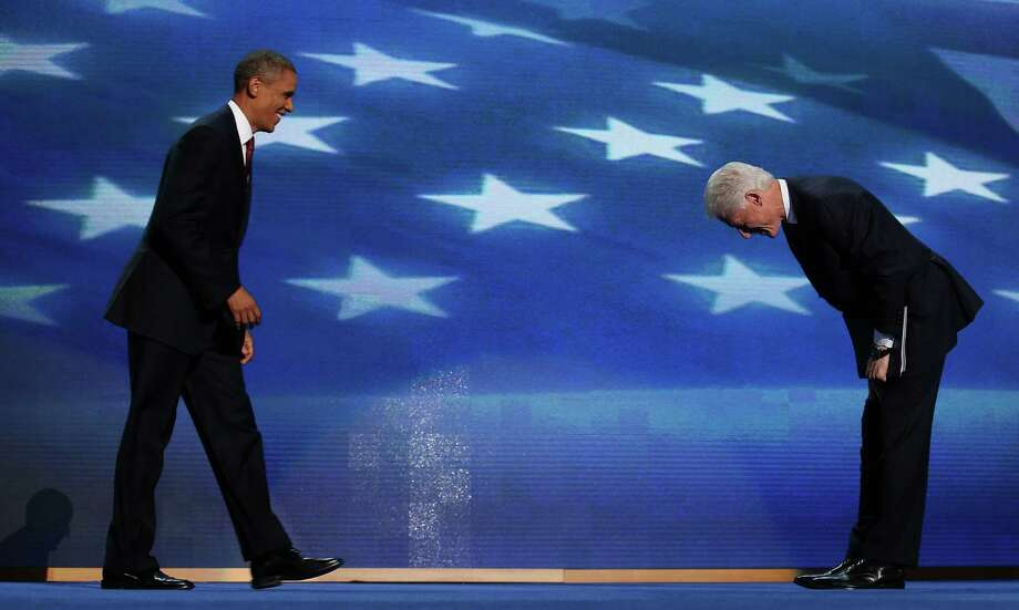 Former U.S. President Bill Clinton greets Democratic presidential candidate, U.S. President Barack Obama (L) on stage during day two of the Democratic National Convention at Time Warner Cable Arena on September 5, 2012 in Charlotte, North Carolina. The DNC that will run through September 7, will nominate U.S. President Barack Obama as the Democratic presidential candidate. Photo: Chip Somodevilla, Getty Images / 2012 Getty Images