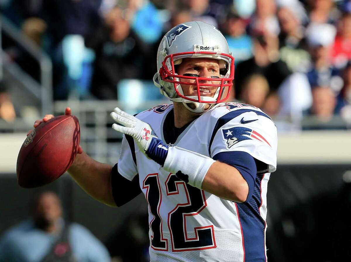 JACKSONVILLE, FL - DECEMBER 23: Tom Brady #12 of the New England Patriots attempts a pass during the game at EverBank Field on December 23, 2012 in Jacksonville, Florida. (Photo by Sam Greenwood/Getty Images)