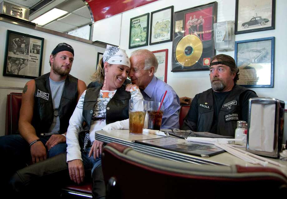 In this Sept. 9, 2012 file photo, Vice President Joe Biden talks to customers at Cruisers Diner during a campaign stop in Seaman, Ohio. The unidentified woman pulled her chair up close to the bench that Biden was seated on in order to speak to him. Photo: Carolyn Kaster, ASSOCIATED PRESS / A2012