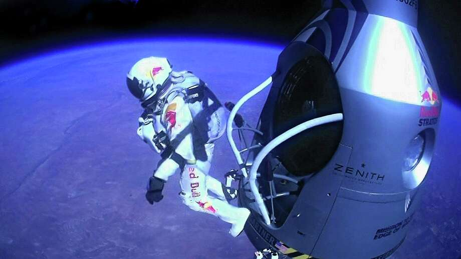 In this Oct. 14, 2012 file photo provided by Red Bull Stratos, pilot Felix Baumgartner of Austria jumps out of the capsule during the final manned flight for Red Bull Stratos. In a giant leap from more than 24 miles up, Baumgartner shattered the sound barrier while making the highest jump ever with a tumbling, death-defying plunge from a balloon to a safe landing in the New Mexico desert. Photo: Uncredited, ASSOCIATED PRESS / Red Bull Content Poo2012
