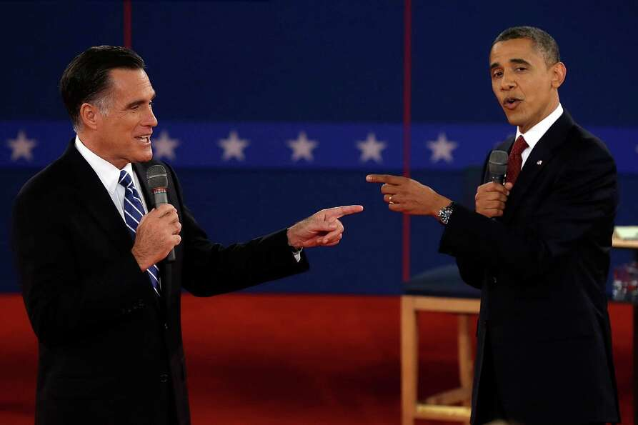 In this Oct. 16, 2012 file photo, Republican presidential nominee Mitt Romney, left, and President B