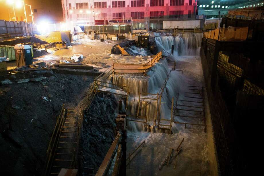 In this Oct. 29, 2012 file photo, sea water floods the Ground Zero construction site in New York. Superstorm Sandy forced the shutdown of mass transit, schools and financial markets, sending coastal residents fleeing, and threatening a dangerous mix of high winds and soaking rain. Photo: John Minchillo, ASSOCIATED PRESS / AP2012