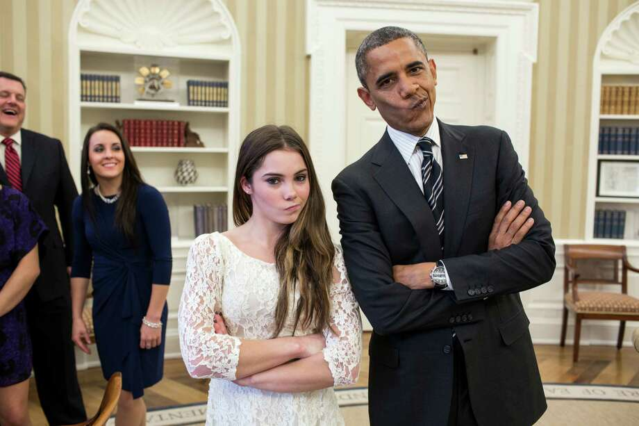 "In this handout image provided by The White House, U.S. President Barack Obama jokingly mimics U.S. Olympic gymnast McKayla Maroney's ""not impressed"" expression while greeting members of the 2012 U.S. Olympic gymnastics teams in the Oval Office November 15, 2012 at the White House in Washington, DC. Maroney's expression became an internet sensation when during the ceremony for her 2012 Olympic vault silver medal she was photographed giving a brief look of disappointment with her lips pursed to the side. Steve Penny, USA Gymnastics President, and Savannah Vinsant laugh at left. Photo: The White House, Getty Images / 2012 The White House"