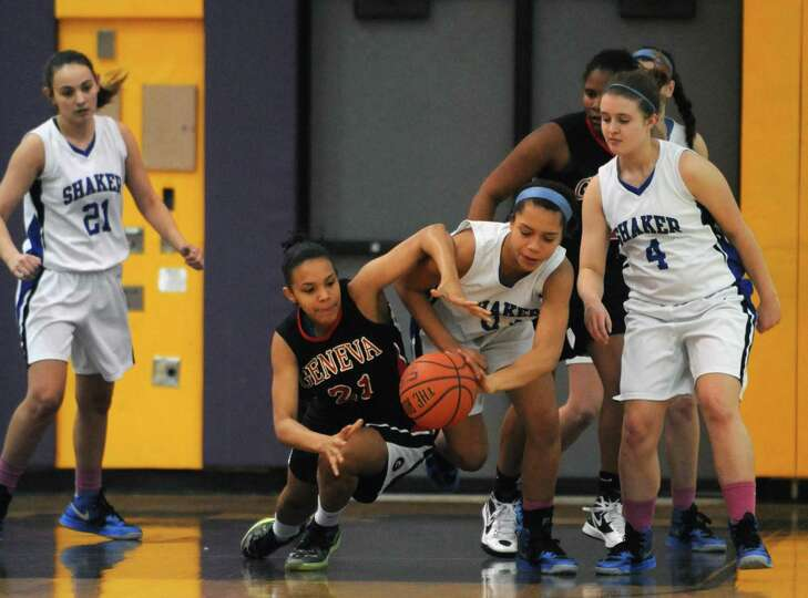 Shaker's Merrick Rowland steals the ball from Geneva's Mia Morrison during their girls high school b