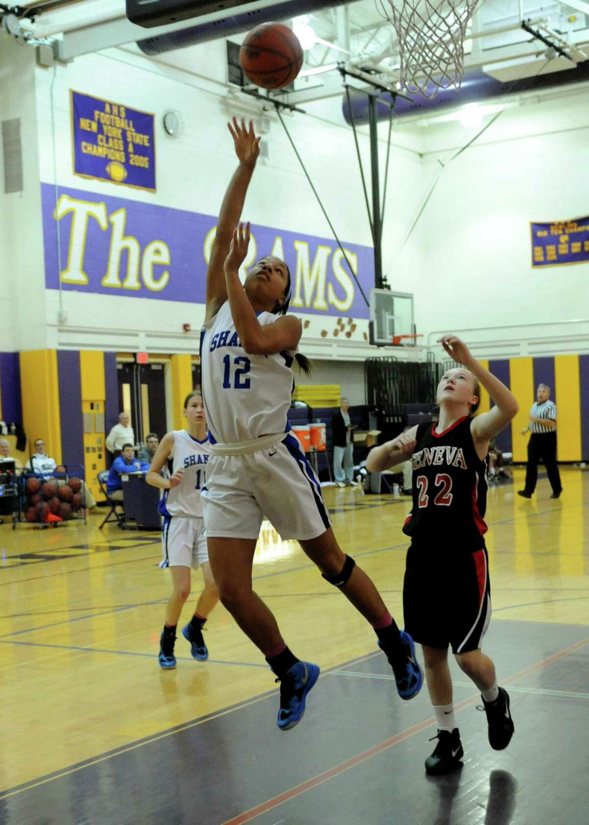 Shaker's Madison Rowland goes in for a basket during their girls high school basketball game against Geneva in Amsterdam, N.Y. Saturday Dec. 29, 2012. (Michael P. Farrell/Times Union)