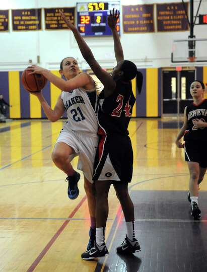 Shaker's Karleigh Huba drives to the basket during their girls high school basketball game against G