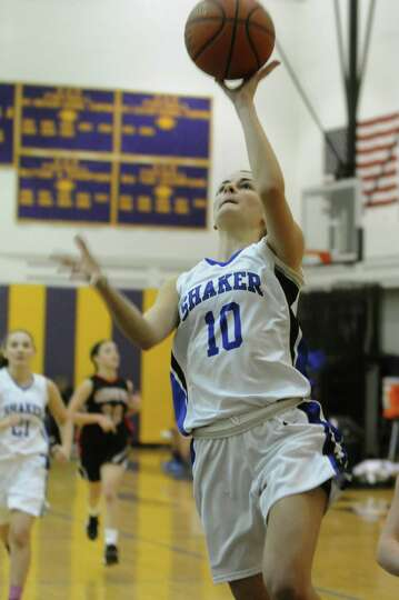 Shaker's Lauren Duffy goes in for a basket during their girls high school basketball game against Ge