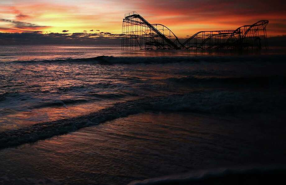 A roller coaster sits in the ocean after the Casino Pier collapsed when Superstorm Sandy hit, on Nov