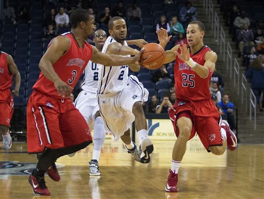 Old Dominion's Aaron Bacote, center, intercepts the pass between Fairfield's Derek Needham, left, and Colin Nickerson, right, during the second half of an NCAA college basketball game Saturday, Dec. 29, 2012 at Ted Constant Convocation Center in Norfolk, Va. (AP Photo/The Virginian-Pilot, Hyunsoo Leo Kim)