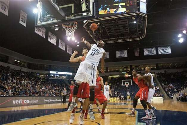 Old Dominion's DeShawn Painter (11) foreground, is fouled by Fairfield's Josip Mikulic, behind, during the second half of an NCAA college basketball game on Saturday, Dec. 29, 2012, in Norfolk, Va. Fairfield won 54-55. (AP Photo/ The Virginian-Pilot, Hyunsoo Leo Kim)