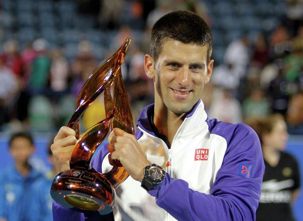 Serbia's Novak Djokovic holds the trophy after he beats Spain's Nicolas Almagro in the final match of the Mubadala Tennis Championship in Abu Dhabi, United Arab Emirates, Saturday, Dec. 29, 2012. (AP Photo/Kamran Jebreili)