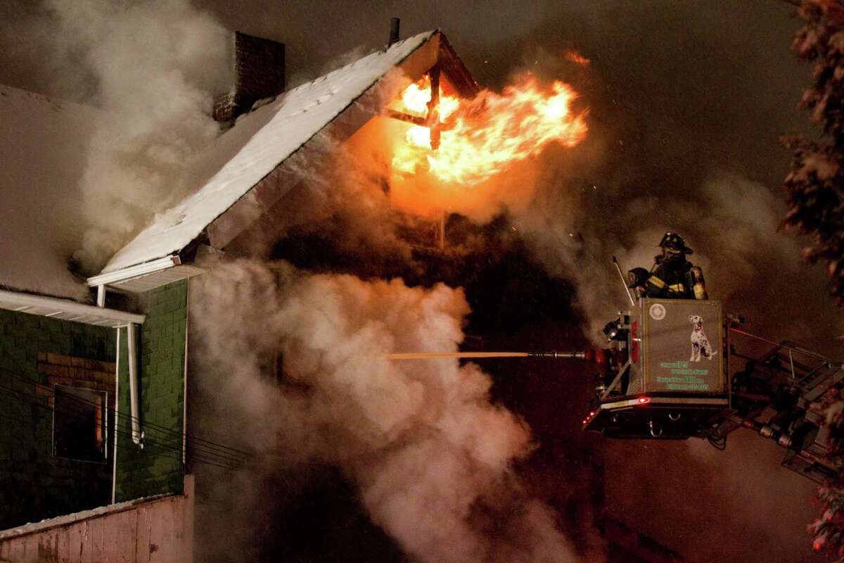 Firefighters battled a blaze at 247 Colorado Avenue, Saturday evening, Dec. 29, 2012, in Bridgeport, Conn.