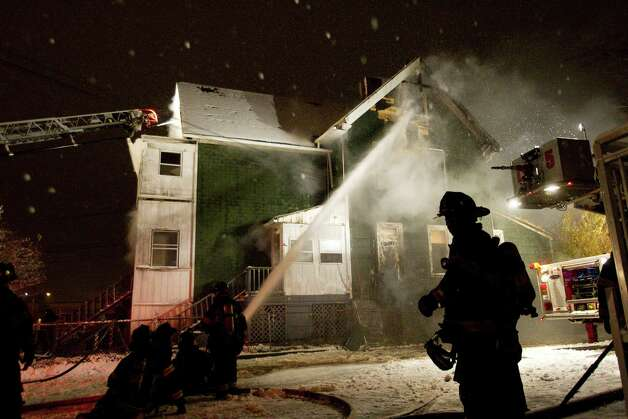 Firefighters battled a blaze at 247 Colorado Avenue, Saturday evening, Dec. 29, 2012, in Bridgeport, Conn. Photo: Brett Coomer, Brett Coomer/Hearst Newspapers / The News-Times