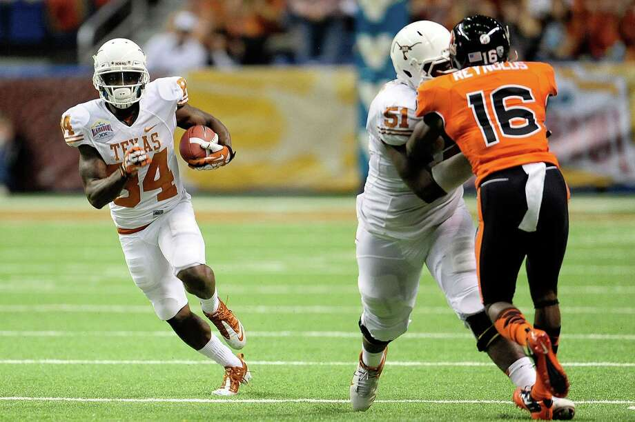 Marquise Goodwin #84 of the University of Texas Longhorns runs for a long touchdown against the Oregon State Beavers during the Valero Alamo Bowl at the Alamodome on December 29, 2012 in San Antonio, Texas. Photo: Stacy Revere, Getty Images / 2012 Getty Images