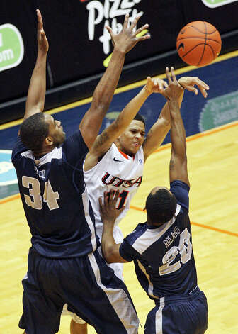 UTSA's Michael Hall III passes between Utah State's Kyisean Reed and Utah State's TeNale Roland during first half action Saturday Dec. 29, 2012 at the UTSA Convocation Center. Photo: Edward A. Ornelas, Express-News / © 2012 San Antonio Express-News