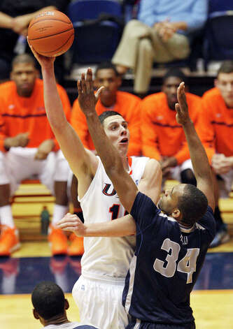 UTSA's Jeromie Hill shoots over Utah State's Kyisean Reed during second half action Saturday Dec. 29, 2012 at the UTSA Convocation Center. Utah State won 71-67. Photo: Edward A. Ornelas, Express-News / © 2012 San Antonio Express-News