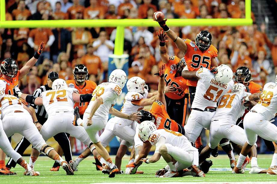 Scott Crichton #95 of the Oregon State Beavers blocks a field goal attempt by Nick Jordan #28 of the University of Texas Longhorns during the Valero Alamo Bowl at the Alamodome on December 29, 2012 in San Antonio, Texas. Photo: Stacy Revere, Getty Images / 2012 Getty Images