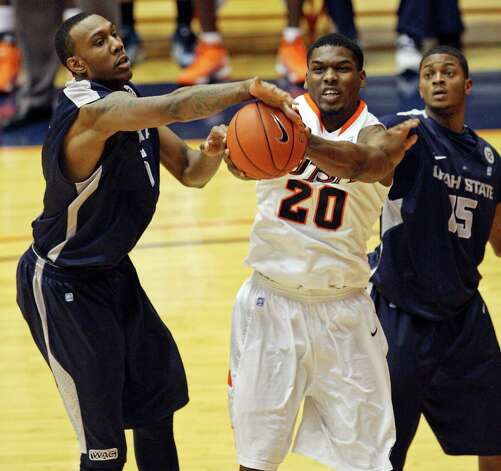 UTSA's Edrico McGregor grabs for a rebound between Utah State's Jarred Shaw and Utah State's Marvin Jean during second half action Saturday Dec. 29, 2012 at the UTSA Convocation Center. Utah State won 71-67. Photo: Edward A. Ornelas, Express-News / © 2012 San Antonio Express-News