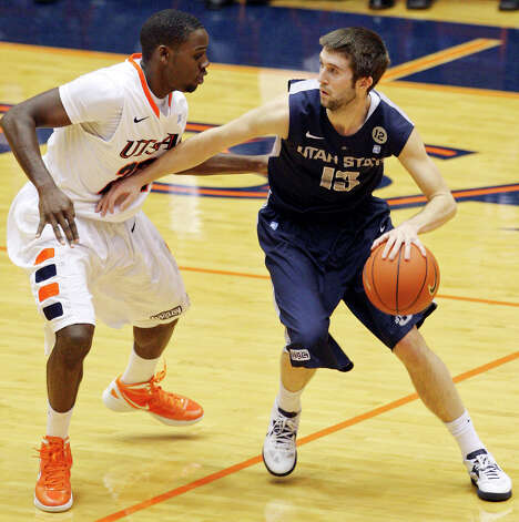 UTSA's Kannon Burrage defends Utah State's Preston Medlin during second half action Saturday Dec. 29, 2012 at the UTSA Convocation Center. Utah State won 71-67. Photo: Edward A. Ornelas, Express-News / © 2012 San Antonio Express-News