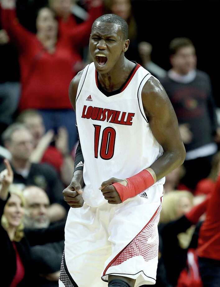 LOUISVILLE, KY - DECEMBER 29:  Gorgui Dieng #10 of the Louisville Cardinals celebrates during the game against the Kentucky Wildcats at KFC YUM! Center on December 29, 2012 in Louisville, Kentucky. Louisville won 80-77.  (Photo by Andy Lyons/Getty Images) Photo: Andy Lyons