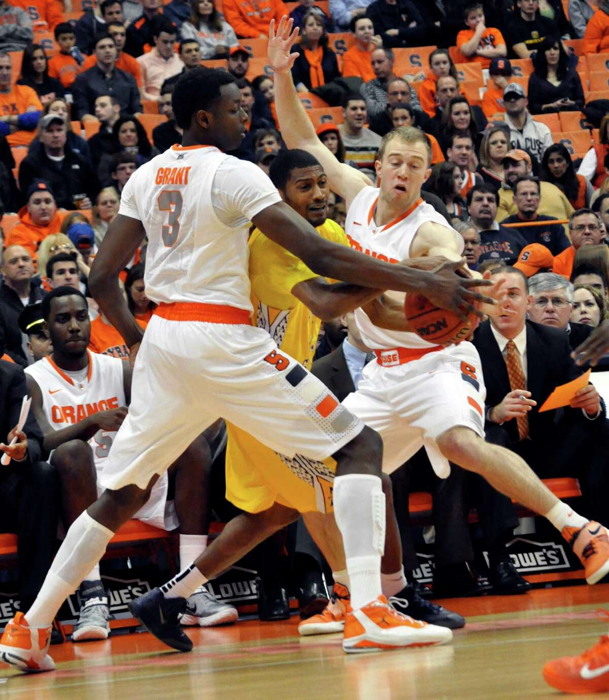 Alcorn State's Anthony Nieves is pressured by Syracuse's Jerami Grant, left, and Trevor Cooney during the first half of an NCAA college basketball game in Syracuse, N.Y., Saturday, Dec. 29, 2012. (AP Photo/Kevin Rivoli)