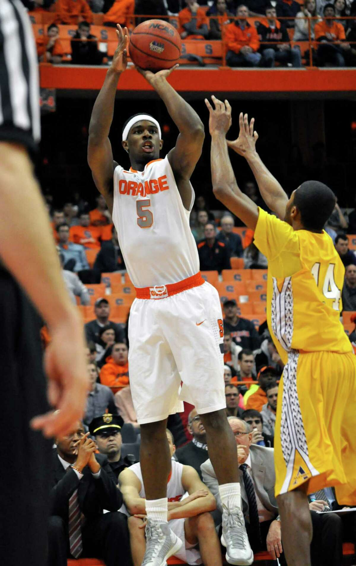 Syracuse's C. J. Fair shoots against Alcorn State's Anthony Nieves during the second half of an NCAA college basketball game in Syracuse, N.Y., Saturday, Dec. 29, 2012. Syracuse won 57-36. (AP Photo/Kevin Rivoli)