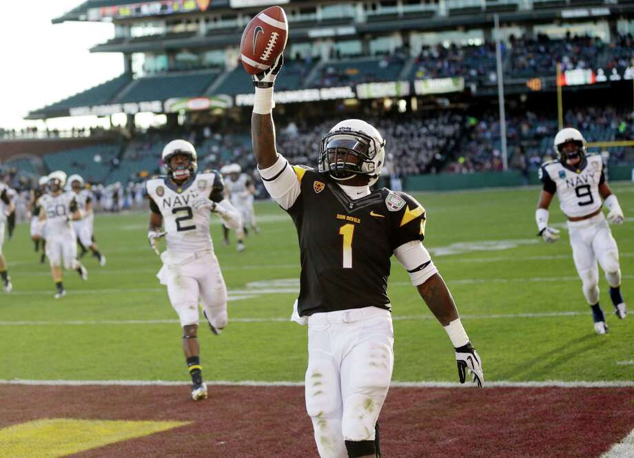Arizona State running back Marion Grice (1) celebrates his 39-yard touchdown run against Navy during the second half of the Fight Hunger Bowl NCAA college football game in San Francisco, Saturday, Dec. 29, 2012. (AP Photo/Marcio Jose Sanchez) Photo: Marcio Jose Sanchez