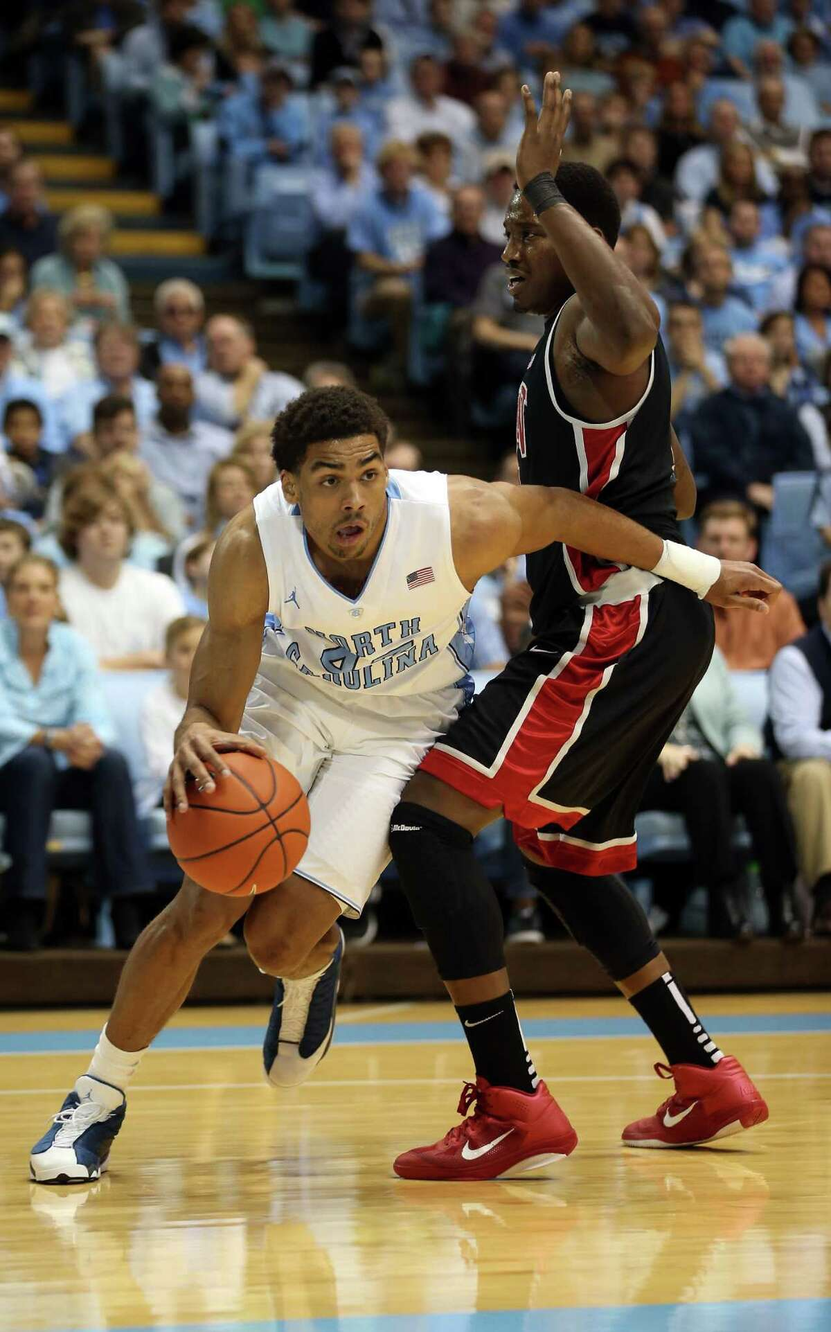 CHAPEL HILL, NC - DECEMBER 29: James Michael McAdoo #43 of the North Carolina Tar Heels drives around Quintrell Thomas #1 of the UNLV Rebels during their game at Dean Smith Center on December 29, 2012 in Chapel Hill, North Carolina. (Photo by Streeter Lecka/Getty Images)