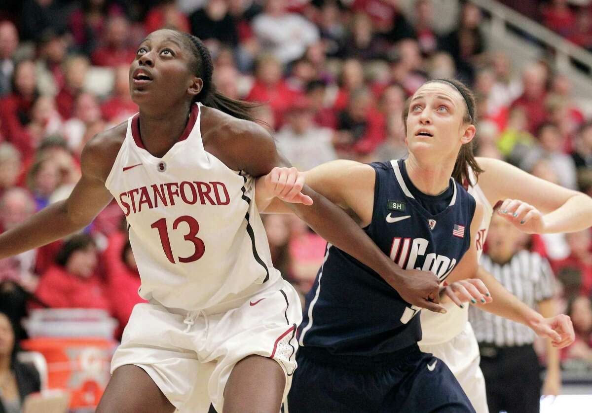 Stanford forward Chiney Ogwumike (13) battles for position against Connecticut guard Kelly Faris (34) during the first half of an NCAA college basketball game in Stanford, Calif., Saturday, Dec. 29, 2012. (AP Photo/Tony Avelar)