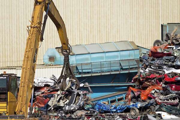 Danger in air near metal recyclers - HoustonChronicle com
