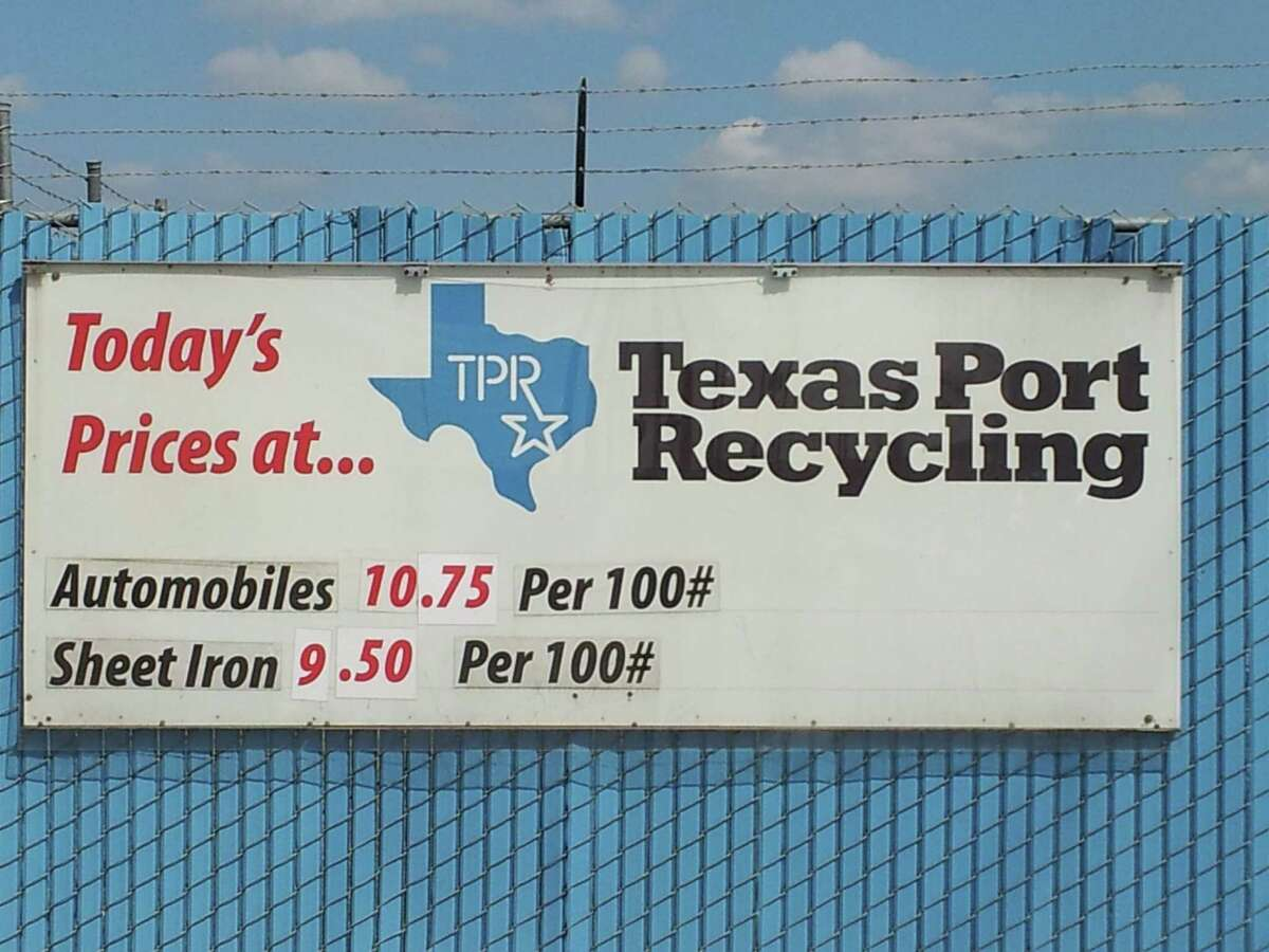 A sign at the metal crushing firm Texas Port Recycling lists daily prices for scrap metal.