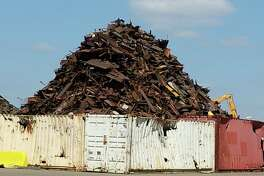 A mountain of scrap metal sits at Texas Port Recycling in Houston's Manchester neighborhood. City officials say the operation has taken steps to reduce emissions and explosions, but residents still complain of smoke.
