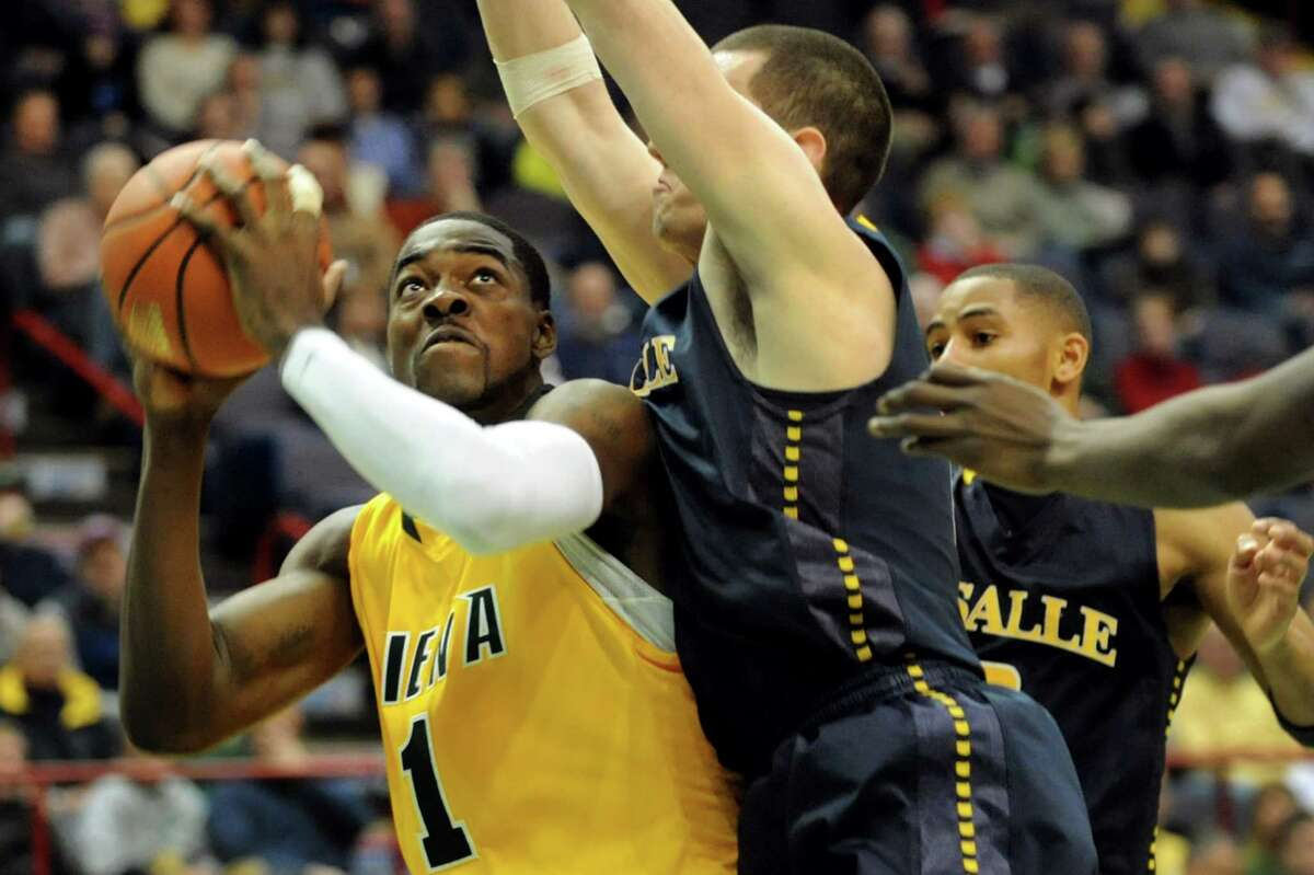 Siena's O.D. Anosike (1), left, looks to the hoop as LaSalle's Steve Zack (0), center, defends during their basketball game on Saturday, Dec. 29, 2012, at Times Union Center in Albany, N.Y. (Cindy Schultz / Times Union)