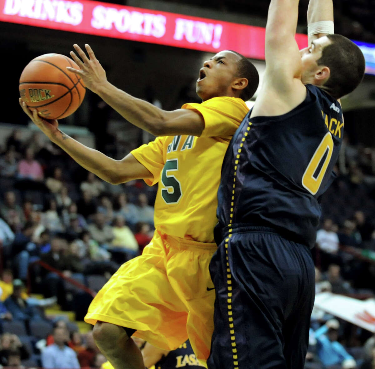 Siena's Evan Hymes (5), left, goes to the hoop as LaSalle's Steve Zack (0) defends during their basketball game on Saturday, Dec. 29, 2012, at Times Union Center in Albany, N.Y. (Cindy Schultz / Times Union)