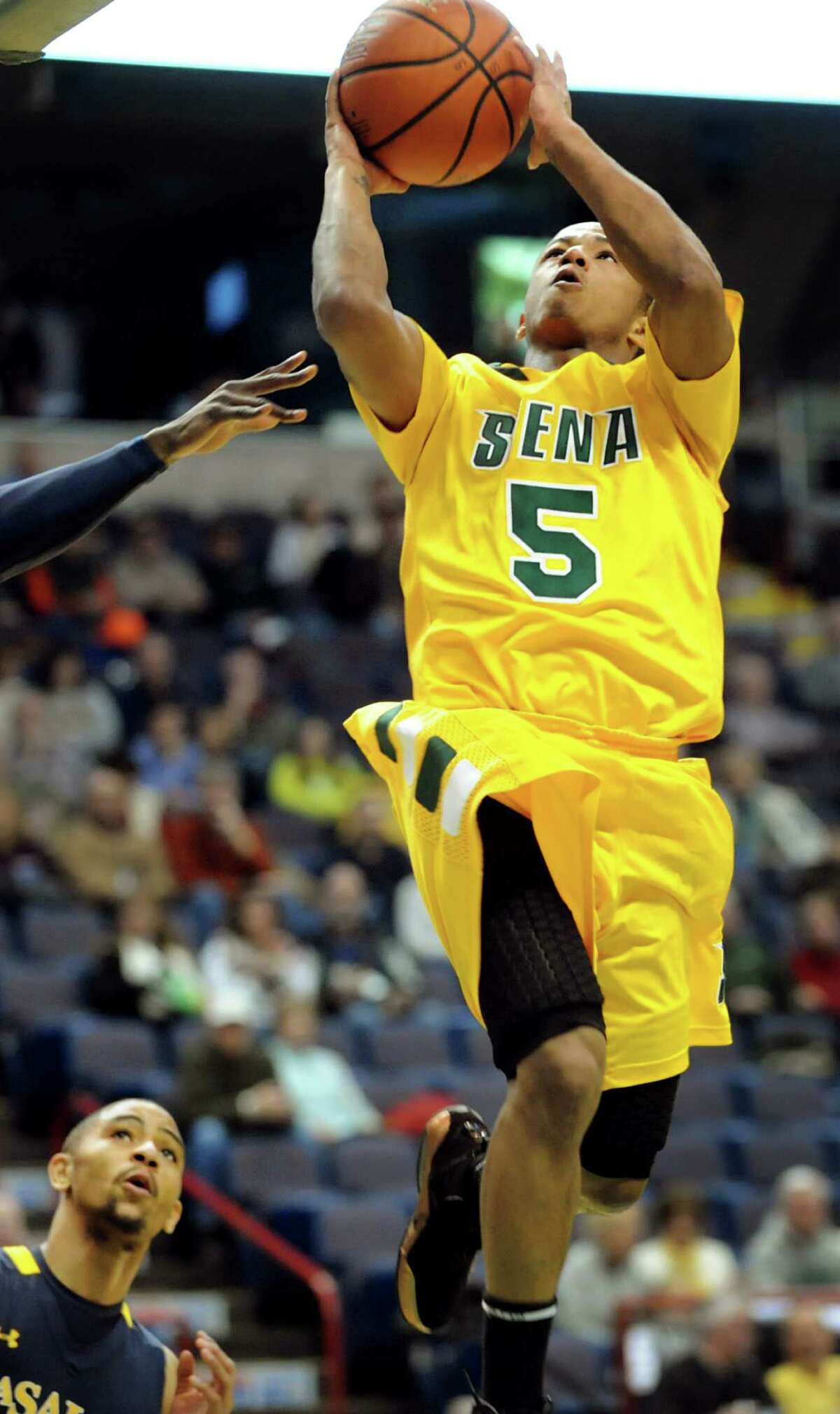 Siena's Evan Hymes (5) goes to the hoop during their basketball game against LaSalle on Saturday, Dec. 29, 2012, at Times Union Center in Albany, N.Y. (Cindy Schultz / Times Union)