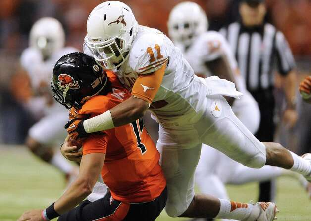 Texas linebacker Tevin Jackson (11) sacks Oregon State quarterback Cody Vaz late in the fourth quarter to help seal the Longhorns' victory in the Valero Alamo Bowl on Saturday, Dec. 29, 2012. Photo: Billy Calzada, Express-News / SAN ANTONIO EXPRESS-NEWS