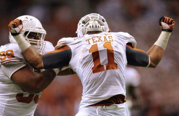 Texas linebacker Tevin Jackson (11) celebrates after sacking Oregon State quarterback Cody Vaz late in the fourth quarter of the Valero Alamo Bowl in the Alamodome on Saturday, Dec. 29, 2012. Teammate Desmond Jackson joins him. Photo: Billy Calzada, Express-News / SAN ANTONIO EXPRESS-NEWS