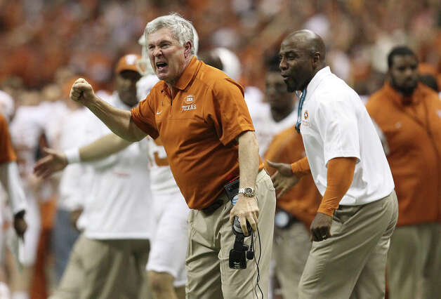 Texas head coach Mack Brown reacts after his team gained the go-ahead score in the fourth quarter against Oregon State in the Valero Alamo Bowl on Saturday, Dec. 29, 2012. Texas won, 31-27. Photo: Kin Man Hui, Express-News / © 2012 San Antonio Express-News