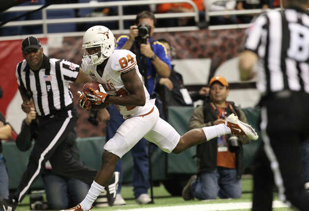 Texas' Marquise Goodwin (84) makes a touchdown catch in the fourth quarter for the go ahead score against Oregon State in the Valero Alamo Bowl on Saturday, Dec. 29, 2012. Texas won, 31-27. Photo: Kin Man Hui, Express-News / © 2012 San Antonio Express-News