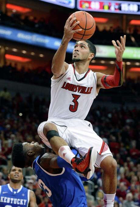 Louisville's Peyton Siva, right, goes over the top of Kentucky's Nerlins Noel for a layup during the second half. Photo: Timothy D. Easley, FRE / FR43398 AP