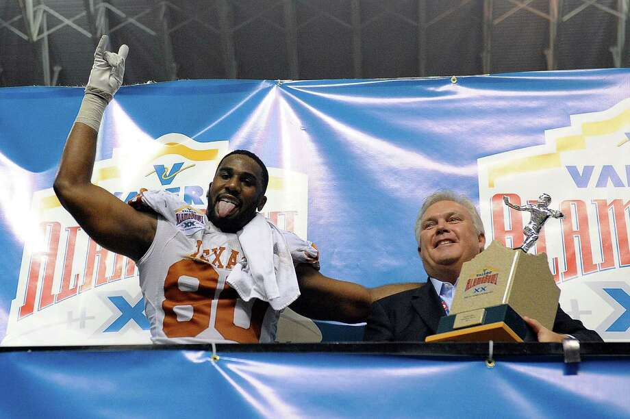 Alex Okafor #80 of the University of Texas Longhorns celebrates as Defensive Player of the game against the Oregon State Beavers in the Valero Alamo Bowl at the Alamodome on December 29, 2012 in San Antonio, Texas.  Texas won the game 31-27. Photo: Stacy Revere, Getty Images / 2012 Getty Images