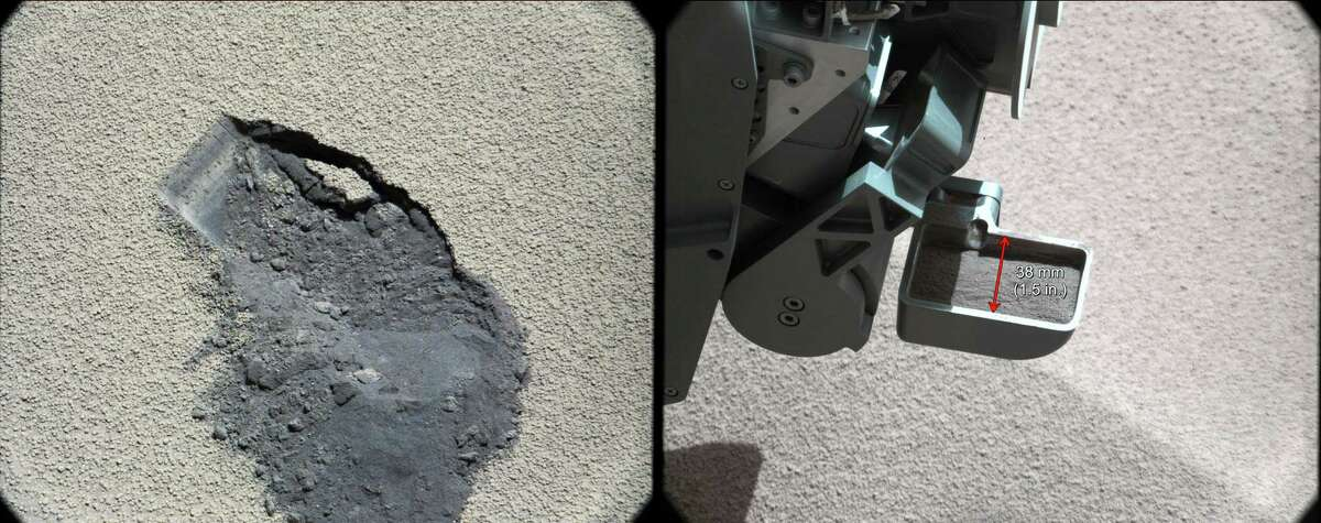 In this image released by NASA on Tuesday Oct. 30, 2012 shows a scoop of Martian soil collected by the NASA's Curiosity rover. An analysis of the soil released Tuesday reveals it contains similar minerals found on Hawaii's Mauna Kea. Curiosity landed on Mars in August on a two-year mission to study whether the environment was habitable. (AP Photo/NASA)