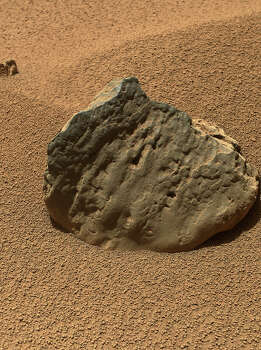 "The Mars Hand Lens Imager (MAHLI) on the arm of NASA's Mars rover Curiosity took this image of a rock called ""Et-Then"" during the mission's 82nd sol, or Martian day (Oct. 29, 2012). Et-Then is located near the rover's front left wheel, where the rover has been stationed while scooping soil at the site called ""Rocknest."" Photo: NASA/JPL-Caltech/MSSS / ONLINE_YES"