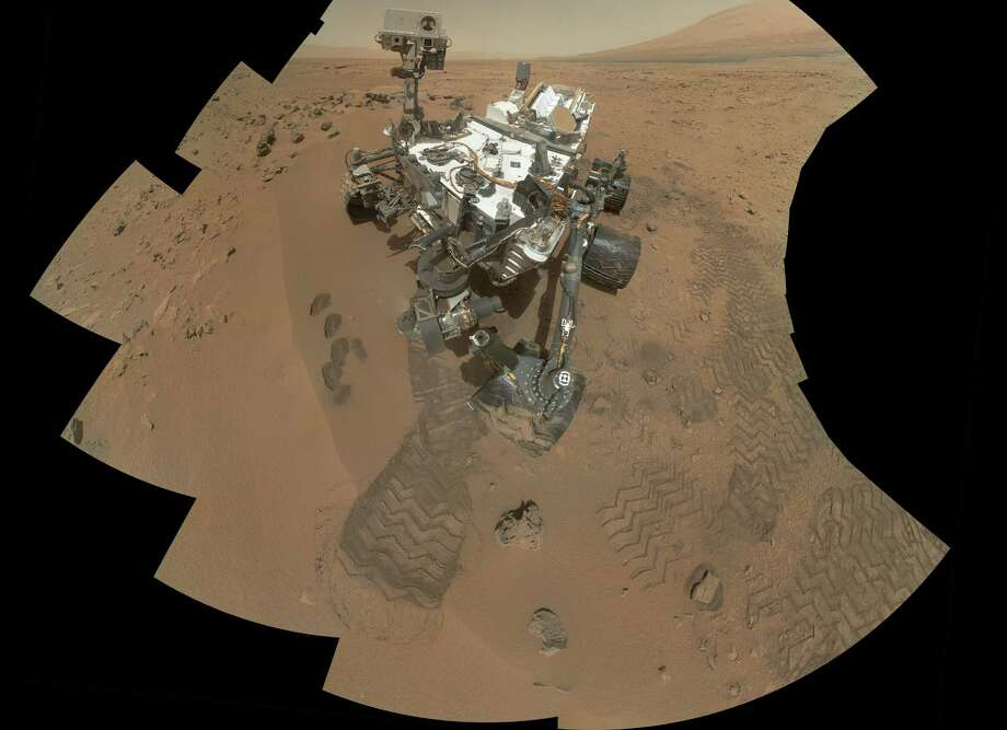 This image released by NASA shows the work site of the NASA's rover Curiosity on Mars. Results are in from the first test of Martian soil by the rover Curiosity: So far, there is no definitive evidence that the red planet has the chemical ingredients to support life.Scientists said Monday, Dec. 3, 2012 that a scoop of sandy soil analyzed by the rover's chemistry lab contained water and a mix of chemicals, but not the complex carbon-based compounds considered necessary for microbial life. (AP Photo/NASA) Photo: HOPD, Associated Press / NASA