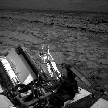 "This Dec. 12, 2012 image provided by NASA shows the Mars rover Curiosity at a pit stop, a shallow depression called ""Yellowknife Bay.""  It took the image on the 125th Martian day, or sol, of the mission, just after finishing that sol's drive. The Sol 125 drive entered Yellowknife Bay and covered about 86 feet (26.1 meters). The descent into the basin crossed a step about 2 feet (half a meter) high, visible in the upper half of this image. Curiosity will now head for Mount Sharp in mid-February after it drills into its first rock. (AP Photo/NASA/JPL-Caltech) Photo: Anonymous, Associated Press / NASA/JPL-Caltech"