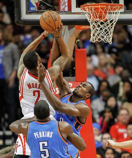 Rockets forward Marcus Morris sees his shot turned away by Thunder forward Serge Ibaka in a night filled with offensive struggles for the Rockets. Photo: Bob Levey, FRE / FR156786 AP